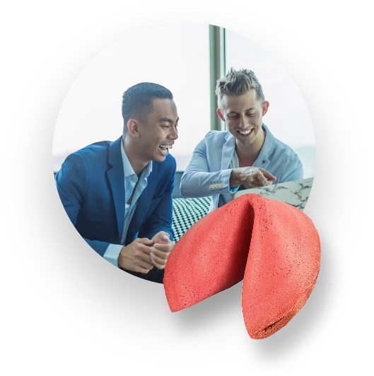Red fortune cookie, two happy young men in the background