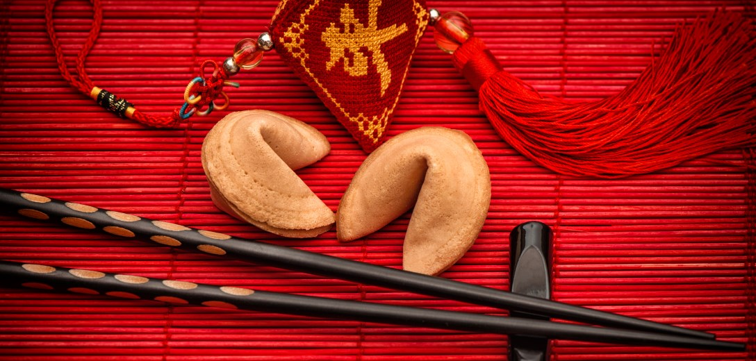 2 fortune cookies with an Asian decoration in red
