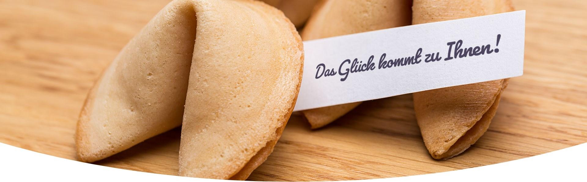 """Two fortune cookies with the slogan """"Das Glück kommt zu Ihnen!"""""""